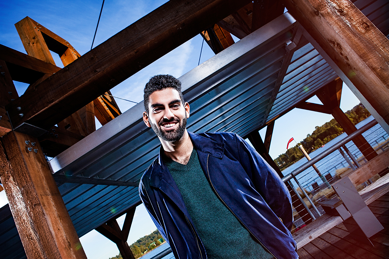 A Douglas College Commerce and Business Administration graduate standing at New Westminster Pier Park, on the Fraser River.