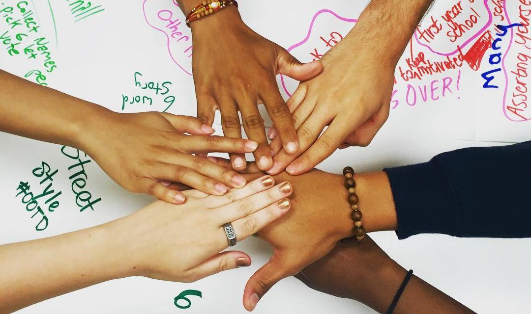 team members hands together