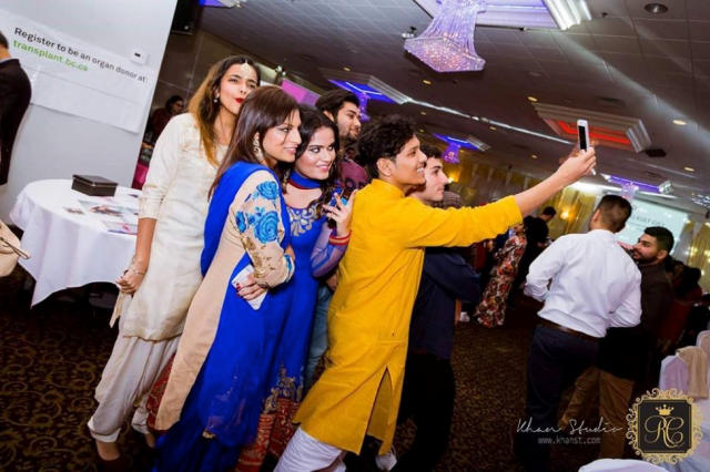 group of students at a diwali party taking a selfie