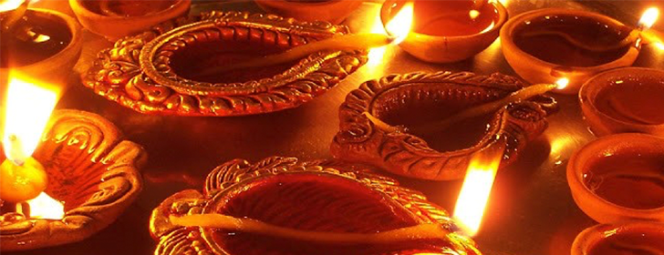 close up of diwali candles lit up