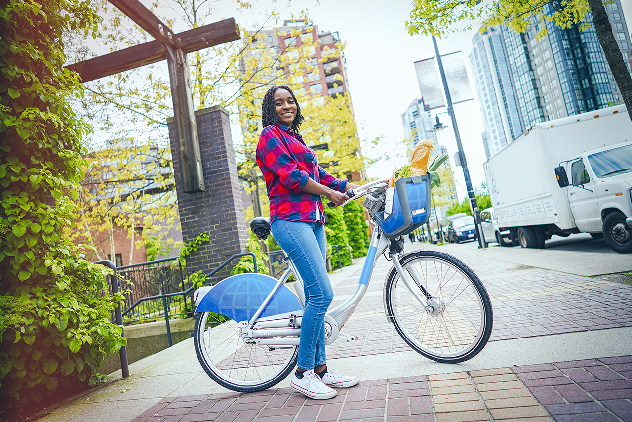 A Douglas College Associate of Arts in Environmental Science student rides her rental bike.