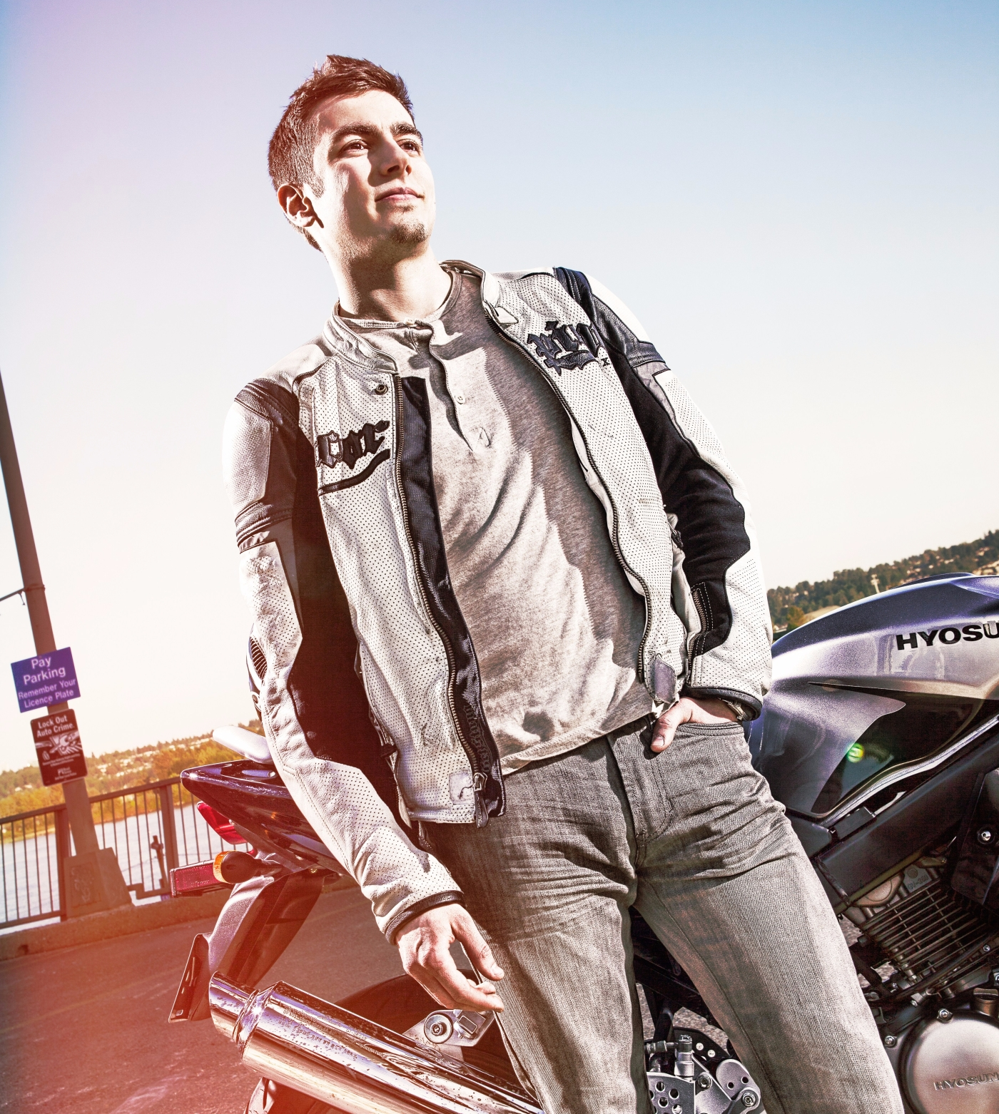 Sanjin stands in front of his motorcycle