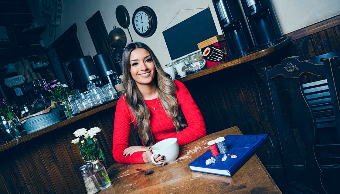 Ravina dhaliwal sits in a cafe drinking coffee