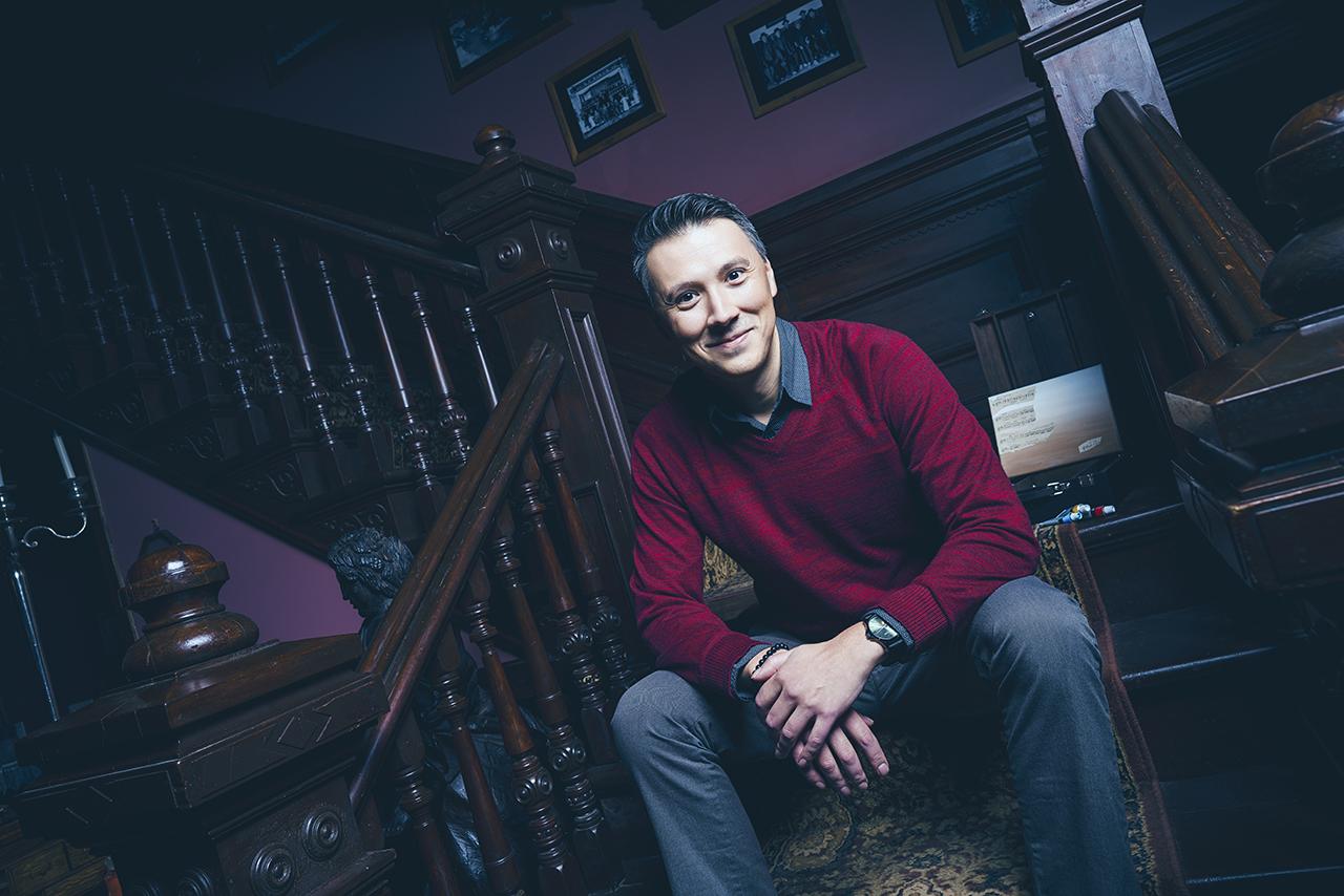 Trevor sits on steps