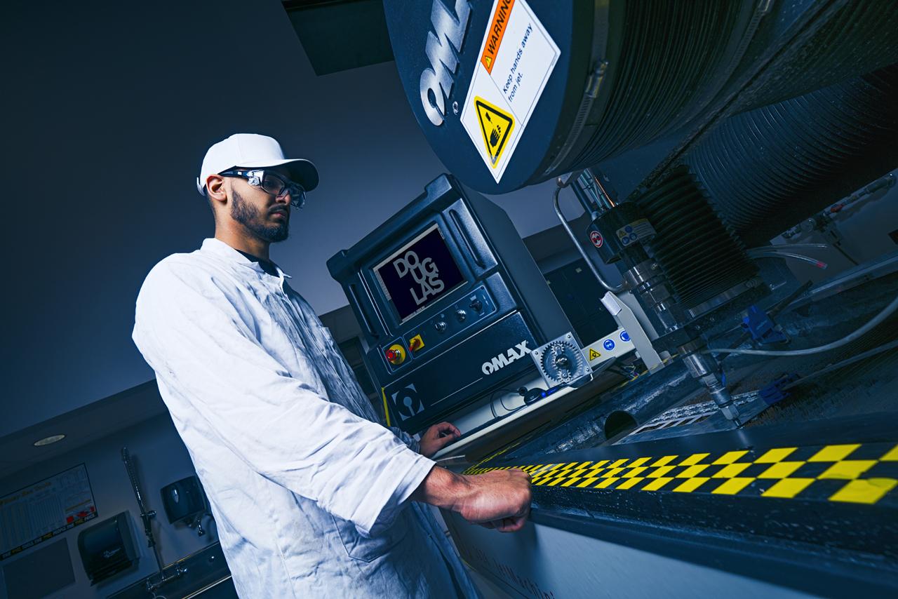 Engingeering student Gurmaan Gary Brar in fabrication lab, photo by David Denofreo