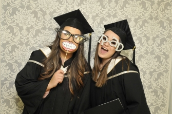 Feb graduates enjoy photobooth props
