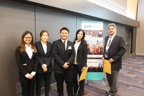 Hospitality Management students post for photo at competition
