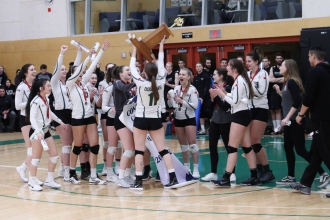 Royals women's volleyball team celebrate with first place trophy at PACWEST championships