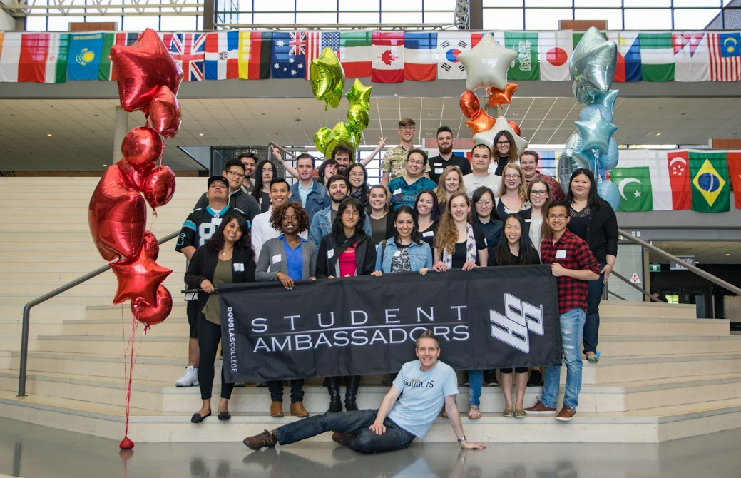 Student Ambassadors pose on the steps of the Concourse at the Douglas College New Westminster Campus.