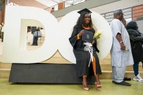 """A colour coordinated grad poses with the iconic """"DO"""" in the New Westminster Campus concourse, Feb. 22."""