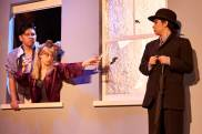 A martini is handed to Man, played by Roisin D'Mello, in this semester's production of 7 Stories in the Studio Theatre.